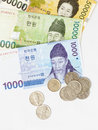 South korean money in notes and coins on white background Royalty Free Stock Photos