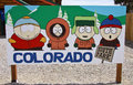 South park characters four kenny cartman stan and kyle from the award winning tv show shown on a sign displayed on the main street Royalty Free Stock Images
