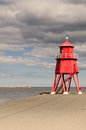 South shields groyne lighthouse the at sits in the mouth of the river tyne to protect the beach and help with navigation Royalty Free Stock Photography