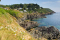 South west coastal path view near polperro cornwall from coast fishing village england Royalty Free Stock Photos