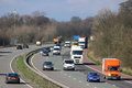 Southbound traffic on m motorway passing scorton lorries and cars mainly the carriageway of the rounding a bend as it passes the Royalty Free Stock Photo