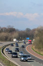 Southbound traffic on m motorway passing scorton one lorry and many cars mainly the carriageway of the rounding a bend as it Royalty Free Stock Image
