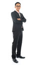 Southeast asian business man full length confident crossed arms standing isolated on white background Stock Photography