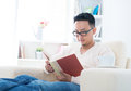 Southeast Asian male reading book Stock Photography