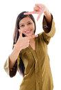 Southeast Asian Muslim female making a frame with fingers Royalty Free Stock Photos
