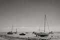 Southend seaside black and white landscape image of beach looking out at the boats on the mud when the sea is out essex england Stock Photo