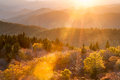 Southern appalachian mountain autumn lens flare warm sun streaks across the peaks and valleys of the scenic mountains in western Stock Image