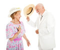 Southern gentleman tipping his hat to a pretty southern belle isolated on white Stock Photos