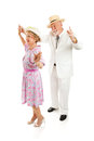 Southern seniors dance senior couple dressed in style dancing together isolated on white Stock Images