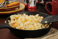 Southern style hash brown potatoes in a cast iron skillet Stock Photography