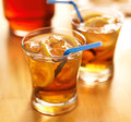 Southern sweet tea with lemon slices and straws close up photo of two glasses of shot extreme selective focus Stock Images