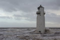 Southerness lighthouse in stormy seas dumfriesshire scotland Royalty Free Stock Photo