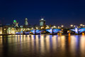 Southwark bridge nightscape and the city of london at night Stock Photo