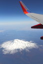 Southwest airlines over mount st helens flies regularly mt and as it has erupted more than any other volcano in the cascade range Royalty Free Stock Photo