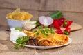 Southwest beef enchilada with sourcream and black beans Stock Image