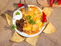 Southwest beef enchilada with sourcream and black beans Stock Photo