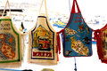 Souvenir aprons marsaxlokk malta for sale on a market stall at Stock Image