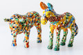 Souvenir colored lizard clay toys donkey and bull gaudi style isolated white Stock Photography