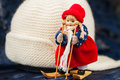 Souvenir little cross country skier , knitted hat Royalty Free Stock Photo