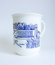 Souvenir mug with the inscription in cyrillic udomlya on a blue background Stock Photo
