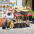 Souvenir shop with hats knickknack and a stuffed man sitting sicily italy Stock Image