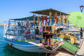 Souvenir shop, organised on fishing boat at port of Chania Royalty Free Stock Photo