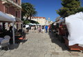 Souvenir shops on the street in the city of Hvar. Royalty Free Stock Photo