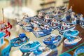 Souvenirs from Kusadasi in the form of small boats and seagulls. A good ceramic gift from the sea. Royalty Free Stock Photo