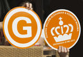 Souvenirs made for visit dutch royal pair to groningen netherlands may two paper orange wave hands from wave at queen maxima and Royalty Free Stock Image