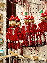 Souvenirs pinocchio marionettes and magnets from rome funny wooden italy Royalty Free Stock Photos