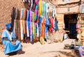 Souvenirs shop old man in traditional clothes selling artisan goods in ait ben haddou morocco Royalty Free Stock Images
