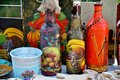 Souvenirs three painted bottle bucket and other of folk art Royalty Free Stock Photos