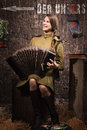 Soviet female soldier in uniform of world war ii with an accordi old accordion Royalty Free Stock Photos