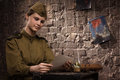 Soviet female soldier in uniform of world war ii reads the letter Royalty Free Stock Images