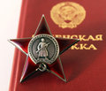 Soviet order red star and soldier document insignia two orders for paticipation heroism in great national war world war second Royalty Free Stock Image