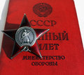 Soviet order red star and soldier document insignia two orders for paticipation heroism in great national war world war second Stock Photo