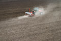 Sowing crops at field with machine Stock Photography