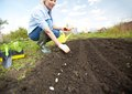 Sowing seed image of female farmer in the garden Royalty Free Stock Image