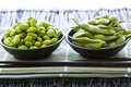 Soy beans in bowls Stock Photos