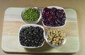 Soy beans, Red beans, black beans and green beans with the healt Royalty Free Stock Photo