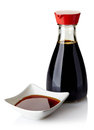Soy sauce bottle and bowl of on white background Royalty Free Stock Photography