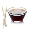 Soy sauce bowl of and two chopsticks on white background Stock Images