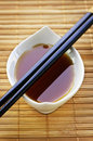 Soy sauce with chopsticks Stock Image