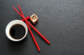 Soy sauce with red chopsticks Royalty Free Stock Photo