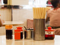 Soy sauce, vinegar, chilli oil, sugar and chopsticks on a table of a hong kong style traditional canteen Royalty Free Stock Photo