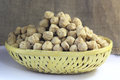 Soya chunks protein in a bamboo basket with jute cloth background Royalty Free Stock Photos