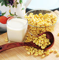 Soybean milk and soybean on kitchen table Stock Image