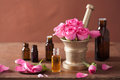 Spa and aromatherapy set with rose flowers mortar essential oils oil Royalty Free Stock Image