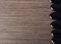 Spa background. black stones on wooden Royalty Free Stock Photos