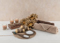 Spa and bath essentials rustic candlelit including body scrub handmade artisan soap in setting Stock Images